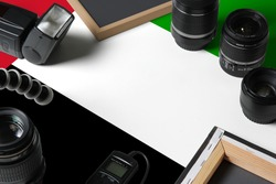United Arab Emirates national flag with top view of personal photographer equipment and tools on white wooden table, copy space.