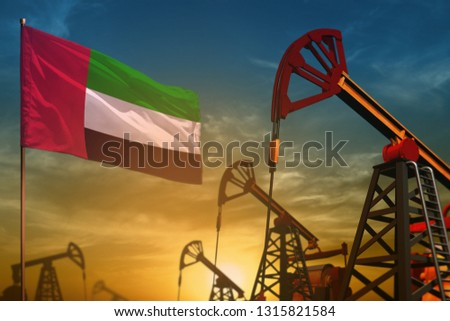 United Arab Emirates oil industry concept, industrial illustration. Fluttering United Arab Emirates flag and oil wells on the blue and yellow sunset sky background - 3D illustration