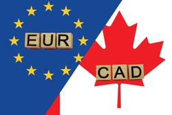 United Europe and Canada currencies codes on national flags background. International money transfer concept