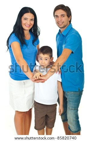 United family with their hands on top each other isolated on white background,selective focus on surprised boy