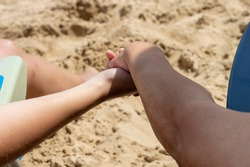 UNITED HANDS OF A MOTHER AND DAUGHTER ON A BACKGROUND OF A BEACH IN GUARDAMAR DEL SEGURA, SPAIN, ON A SUMMER MORNING