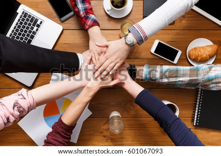 United hands team in office concept. Alliance and cooperation, casual business people connection, top view #601067093