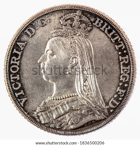 United Kingdom A coin commemorating featuring a portrait of Queen Victoria British Silver 'Jubilee Head'. Crown Coin. Crowned Victoria left Legend: VICTORIA D:G: BRITT:REG:F:D:Years: 1890 Coins. Stock fotó ©