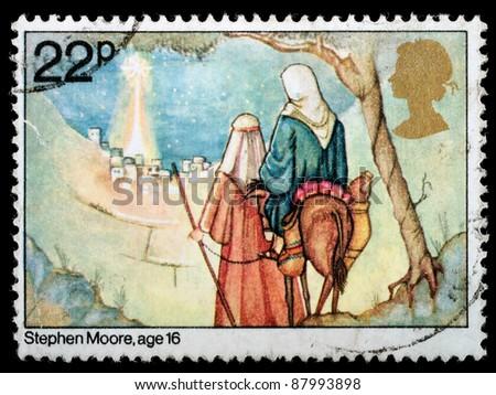 UNITED KINGDOM - CIRCA 1981: A British Used Christmas Postage Stamp showing Childrens Picture of Joseph and Mary Arriving in Bethlehem, circa 1981