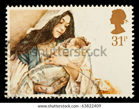 UNITED KINGDOM - CIRCA 1984: A British Used Christmas Postage Stamp showing Mary and Baby Jesus, circa 1984