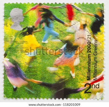 UNITED KINGDOM - CIRCA 2000: a stamp from the United Kingdom shows image of children dancing in one of the 245 Millennium Greens created across the United Kingdom, circa 2000