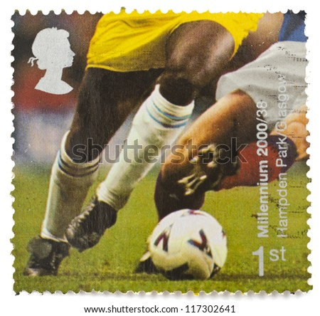 UNITED KINGDOM - CIRCA 2000: a stamp from the United Kingdom shows image of footballers playing at Hampden Park in Glasgow, from the Millennium series, circa 2000