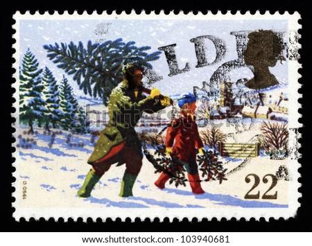 UNITED KINGDOM - CIRCA 1991: A stamp printed in England, shows a village Christmas scene, Christmas tree, circa 1991.