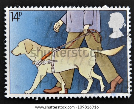 UNITED KINGDOM - CIRCA 1981: A stamp printed in Great Britain shows Blind Man with Guide Dog, circa 1981