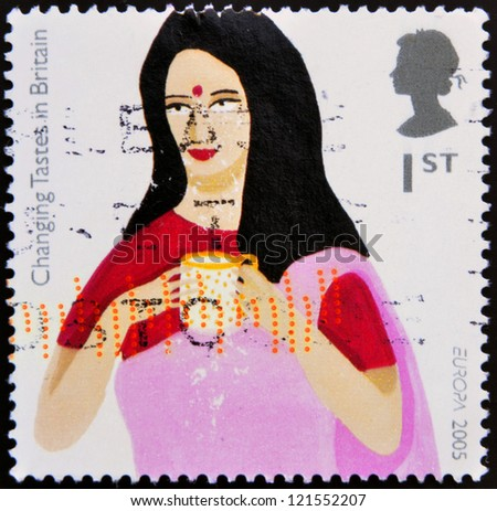 UNITED KINGDOM - CIRCA 2005: A stamp printed in Great Britain shows Indian Woman drinking Tea, circa 2005