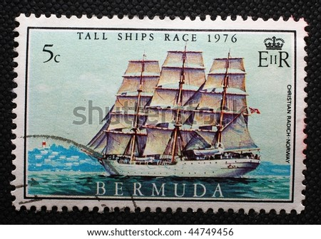 UNITED KINGDOM - CIRCA 1976: A stamp printed in the UK shows image of a ship off the coast of Bermuda, circa 1976