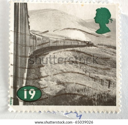 UNITED KINGDOM - CIRCA 1994: A stamp printed in the United Kingdom shows image of a train winding its way through rural Britain, circa 1994