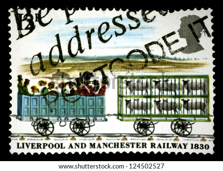 "UNITED KINGDOM - CIRCA 1980: A stamp printed in United Kingdom shows a 3rd class and cars with sheep, with inscriptions and name of series ""Liverpool and Manchester railway, 1830"", circa 1980"