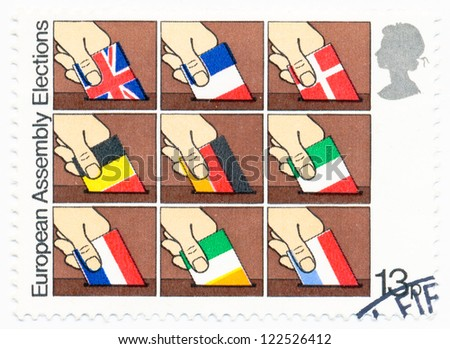 UNITED KINGDOM - CIRCA 1979: A stamp printed in United Kingdom shows Flags of Member Nations as Ballots Positions of hands, circa 1979