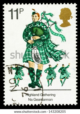 UNITED KINGDOM - CIRCA 1976: A used postage stamp printed in Britain celebrating British Cultural Traditions, showing Scots Piper with Bagpipes, circa 1976