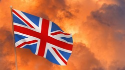 United Kingdom flag on pole. Dramatic background. National flag of United Kingdom