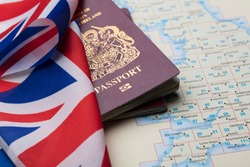 United Kingdom passport with Union Jack flag and map