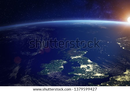United Kingdom (UK) from space at night with city lights of the City of London, England, Wales, Scotland, Northern Ireland, communication technology, 3d render of planet Earth, elements from NASA #1379599427