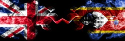 United Kingdom vs Swaziland, Swazi smoky mystic flags placed side by side. Thick colored silky smoke flags of Great Britain and Swaziland, Swazi.