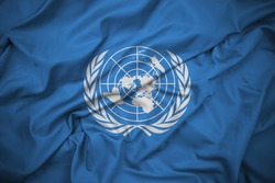 United Nations Flag. Official emblem of the UN in white on a blue background. Silk Fabric