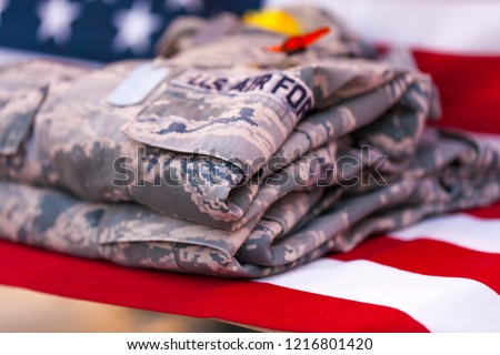 United States Air Force uniform on USA flag, shallow depth of field image