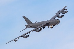United States Air Force (USAF) Boeing B52 Nuclear Bomber turning towards the camera against a blue sky