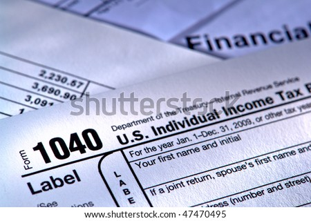 United States American IRS Internal Revenue Service income tax filing form 1040 for revenue reporting preparation with financial papers