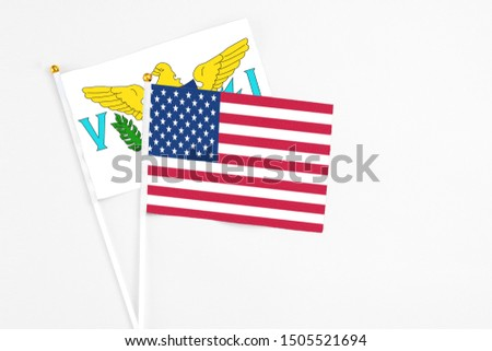 United States and United States Virgin Islands stick flags on white background. High quality fabric, miniature national flag. Peaceful global concept.White floor for copy space. #1505521694