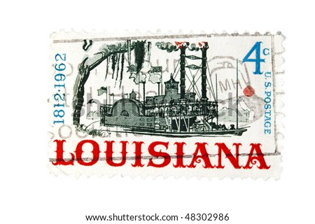 """UNITED STATES - CIRCA 1962: A 4 cent Vintage US postage stamp celebrating the 150th anniversary of the State of Louisiana, depicting a paddle steamboat, with inscription """"1812-1962"""", circa 1962"""