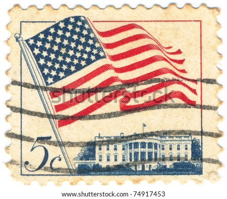 UNITED STATES - CIRCA 1962: A 5 cents stamp printed in the United States features waving US flag, circa 1962