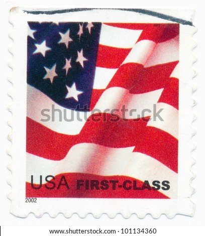 UNITED STATES - CIRCA 2002: A postage stamp printed in the United States, features waving US flag, first-class, circa 2002