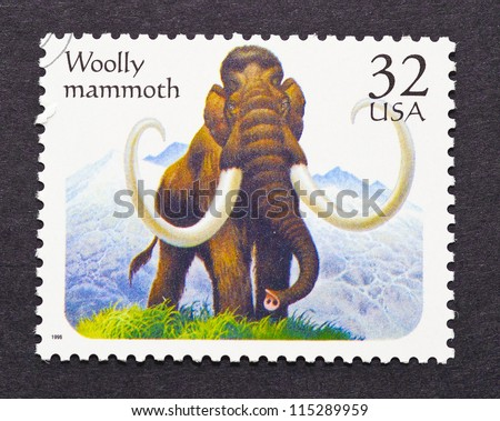 UNITED STATES - CIRCA 1996: a postage stamp printed in United States showing a Woolly Mammoth a Prehistoric animal, circa 1996. - stock photo