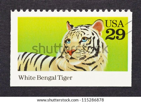 UNITED STATES - CIRCA 1992: a postage stamp printed in United States showing an image of a white bengal tiger, circa 1992. - stock photo