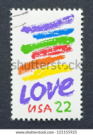 UNITED STATES - CIRCA 1980: a postage stamp printed in United States showing the word Love with six color lines, circa 1980.