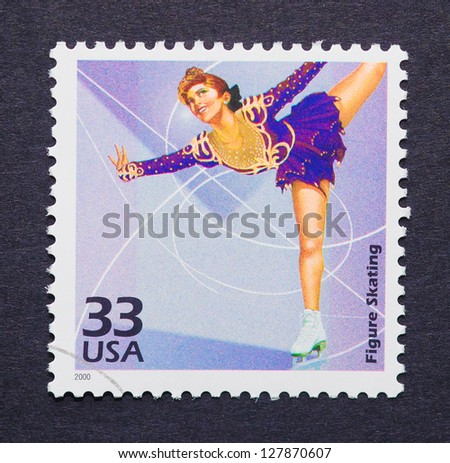 UNITED STATES - CIRCA 2000: a postage stamp printed in USA showing an image of a woman figure skating, circa 2000.