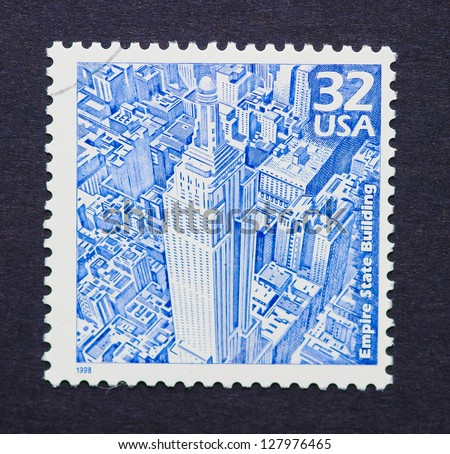 UNITED STATES � CIRCA 1998: a postage stamp printed in USA showing an image of the Empire State Building, circa 1998.