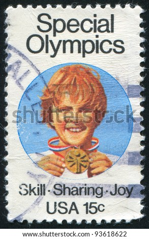 UNITED STATES - CIRCA 1979: A stamp printed by United States of America, shows child holding medal, circa 1979 - stock photo