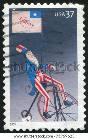 UNITED STATES - CIRCA 2003: A stamp printed by United States of America, shows cycling man with USA flag, circa 2003