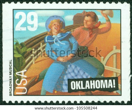"""UNITED STATES - CIRCA 1993: A stamp printed by United States of America, shows heroes of musical """"Oklahoma"""", circa 1993"""