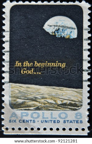 UNITED STATES - CIRCA 1969: A stamp printed in USA shows Moon surface and Earth, circa 1969 - stock photo