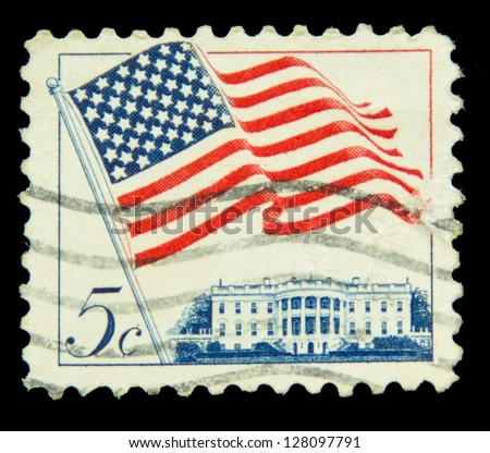 "UNITED STATES - CIRCA 1963: stamp printed in United states, shows image of White House and American Flag, series ""Flag Issue"", circa 1963"