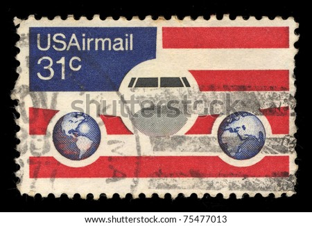 UNITED STATES - CIRCA 1976: stamp printed in United states, shows Plane Globes and flag, circa 1976
