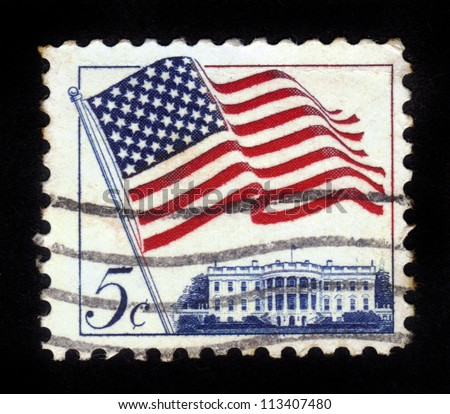 "UNITED STATES - CIRCA 1963: stamp printed in United states (USA), shows image of White House and American Flag, series ""Flag Issue"", circa 1963"