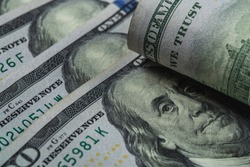 United States Currency . USD , also called as the U.S. dollar, or American dollar.  Money Background. Benjamin Franklin.