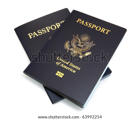 United States dark blue Passports arranged on an isolated white background