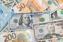 United States dollar, euro and Canadian dollar. Banknotes as Background, Different currencies of the western World. Currency Exchange and Market Trade