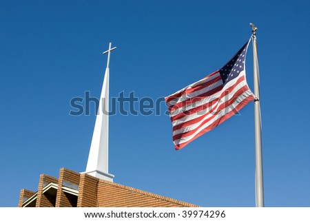 United States flag flies in front of a church steeple topped by a Christian cross.