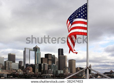 United States flag flies over city of Seattle, Washington