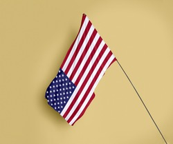 United States flag fluttering on a subtle yellow background