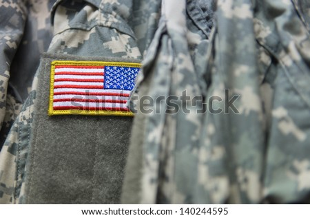 United States flag patch on the army uniform sleeve (Memorial day, Veteran's day, 4th of july, Independence day) #140244595